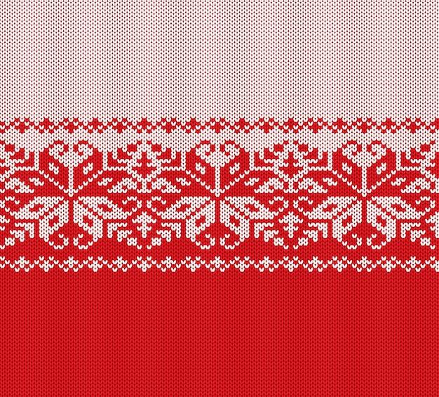 Gestrickte weihnachtsrote und weiße geometrische mit blumenverzierung. weihnachten stricken winter pullover textur design.