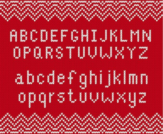 Gestrickter strukturierter hintergrund mit alphabet. gestrickte geometrische verzierung mit buchstaben im skandinavischen stil.