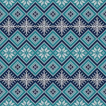 Gestricktes nahtloses muster mit schneeflocken und skandinavischer verzierung für weihnachts- oder winterdesign