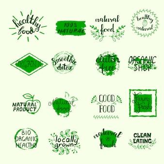 Gesunde lebensmitteletiketten legen mit bio-öko und organischen elementen in grünen farben an