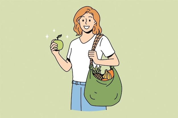 Gesundes essen und lifestyle-konzept. junge lächelnde frauenzeichentrickfilm-figur, die mit einkaufstasche voller frischer früchte nach marktvektorillustration steht