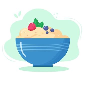 Gesundes essen zum frühstück. haferflockenbrei mit himbeere und blaubeere in einer schüssel.