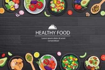 Gesundes Lebensmittel mit Bestandteilen auf dem dunklen Holztisch