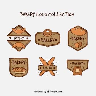 Gezeichnete art der bäckereilogosammlung in der hand