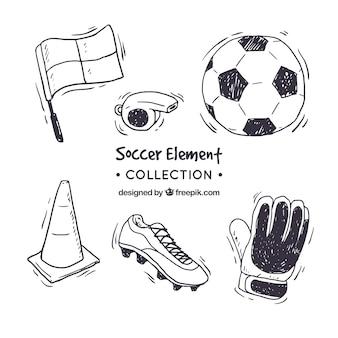 Gezeichnete art der fußballelement-sammlung in der hand