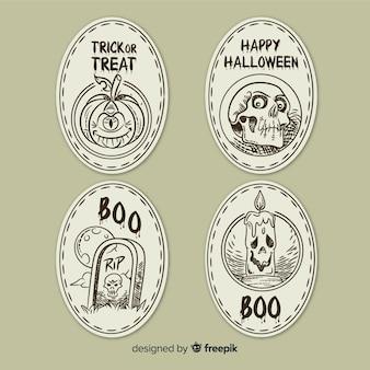 Gezeichnete art der halloween-aufklebersammlung in der hand