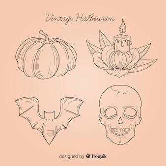 Gezeichnete art der halloween-elementsammlung in der hand
