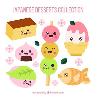 Gezeichnete art der japanischen nachtischsammlung in der hand