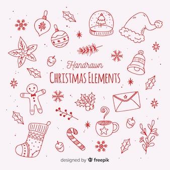 Gezeichnete art der weihnachtselementsammlung in der hand