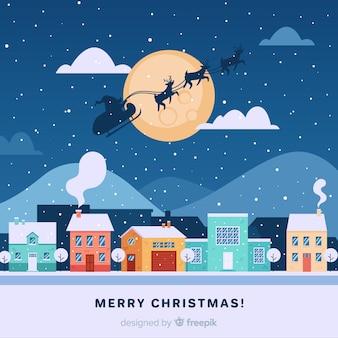 Gezeichnete art der weihnachtsstadt in der hand