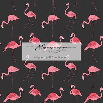 Gezeichnete art des flamingomuster in der hand