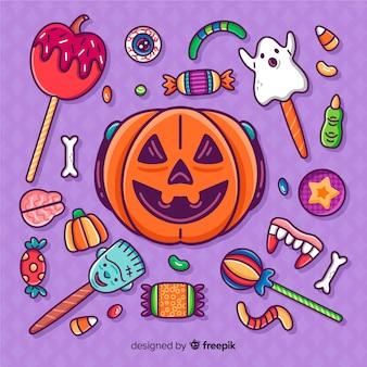 Gezeichnete halloween-süßigkeitsaufklebersammlung der nahaufnahme hand