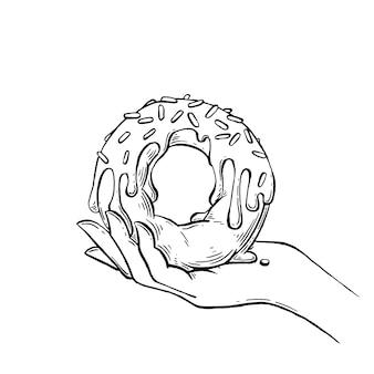 Gezeichnete illustration des donuts in der hand hand.