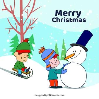 Gezeichneter hintergrund der frohen weihnachten hand mit kindern und einem schneemann
