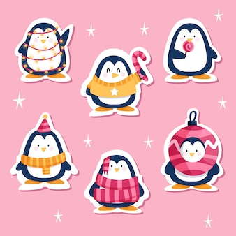 Gezeichneter lustiger aufkleber eingestellt mit pinguinen