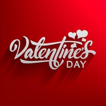 Gezeichneter text des valentinstags hand mit dem fallenden schatten lokalisiert auf rot