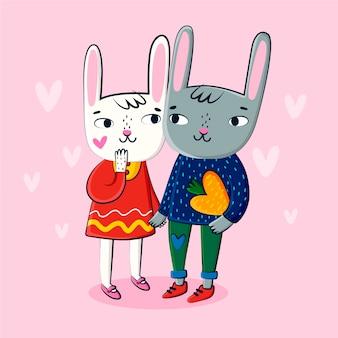 Gezeichneter valentinsgrußhintergrund der kaninchenpaare hand