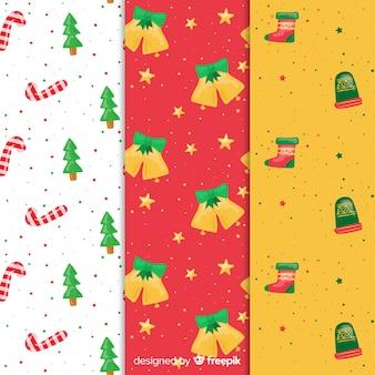 Gezeichnetes design der weihnachtsmustersammlung in hand