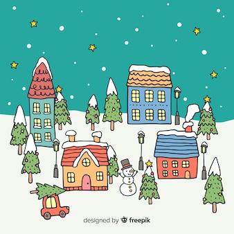 Gezeichnetes design der weihnachtsstadt in der hand