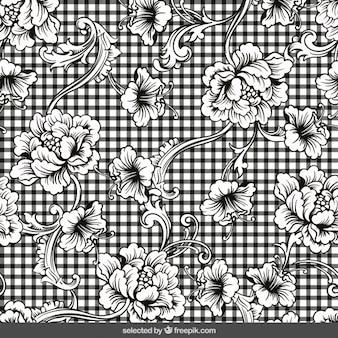 Gingham hintergrund mit floralen ornamenten