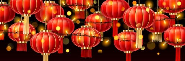 Girlanden auf chinesischen laternen oder porzellanpapierlampen mit leuchtendem licht