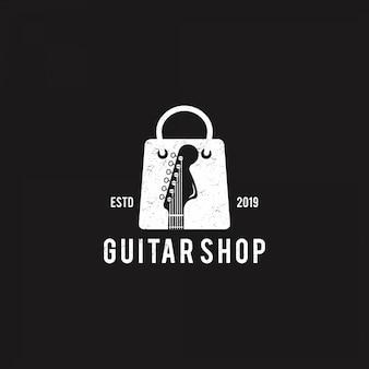 Gitarrenladen-logo auf schwarzem hintergrund