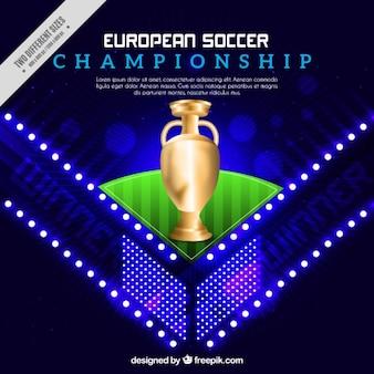 Glänzend hintergrund mit einer goldenen trophäe der fußball-europameisterschaft