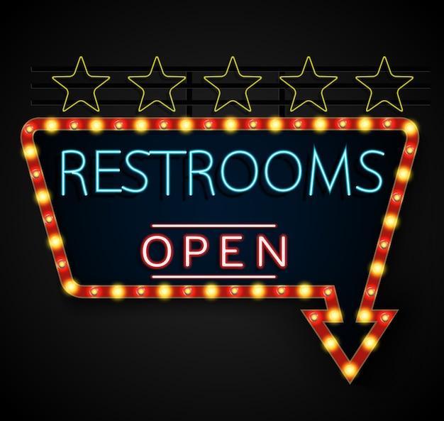 Glänzende retro- helle fahne restrooms auf einem schwarzen hintergrund