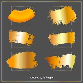 Glänzender goldener pinselstrichsatz
