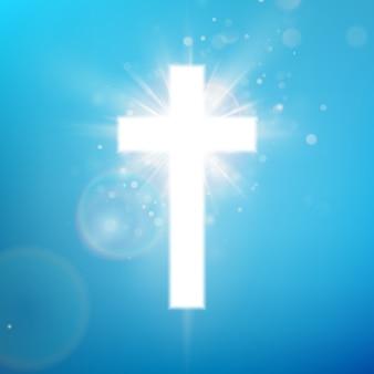 Glänzender weißer kreuzeffekt auf blauem himmel. leuchtendes heiliges kreuz. riligious symbol. oster- und weihnachtszeichen.