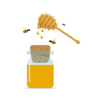 Glas honig mit holzsprudler isoliert auf weißem hintergrund