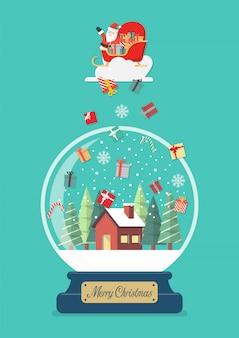 Glaskugel der frohen weihnachten mit sankt im schlitten mit den geschenkboxen, die zum winterhaus fallen