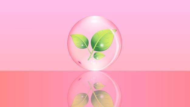 Glaskugel mit einer grünen pflanze im inneren