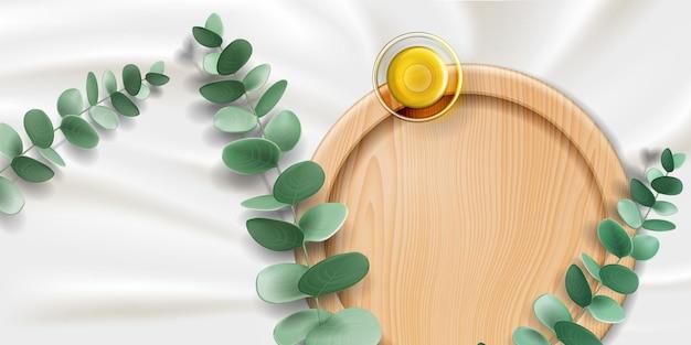 Glasschale mit eukalyptusöl und pflanzenzweig mit blättern