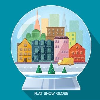 Glasweihnachtskugel mit winterstadtbild und schnee im flachen stil auf blau