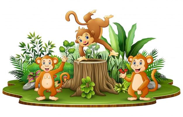 Glückliche affegruppe mit grünpflanzen