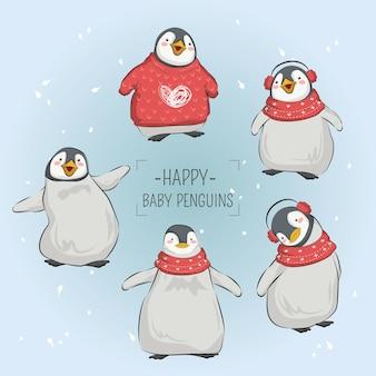 Glückliche baby-pinguine im weihnachten