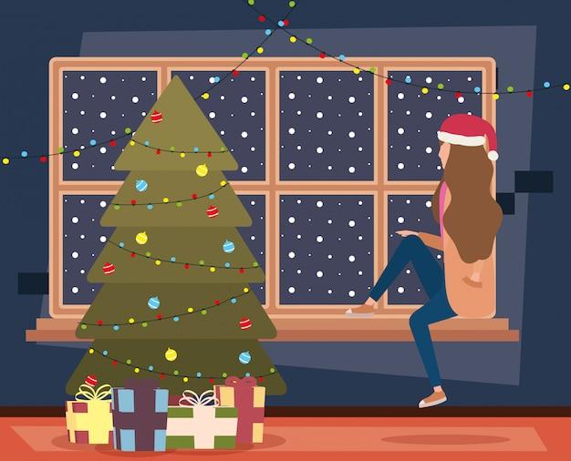 Glückliche dame der frohen weihnachten, die mit baum feiert