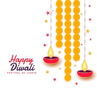 Glückliche diwali-grußkarte mit diya und ringelblumenblume