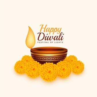 Glückliche diwali-karte mit diya und ringelblumenblume