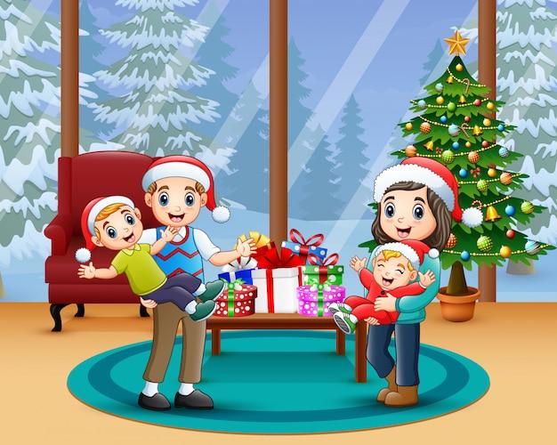 Glückliche familie, die ein weihnachten am haus feiert