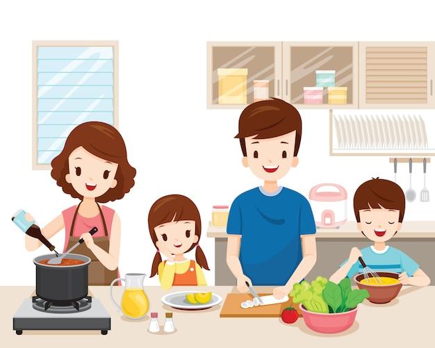 Glückliche familie, die essen in der küche zusammen kocht
