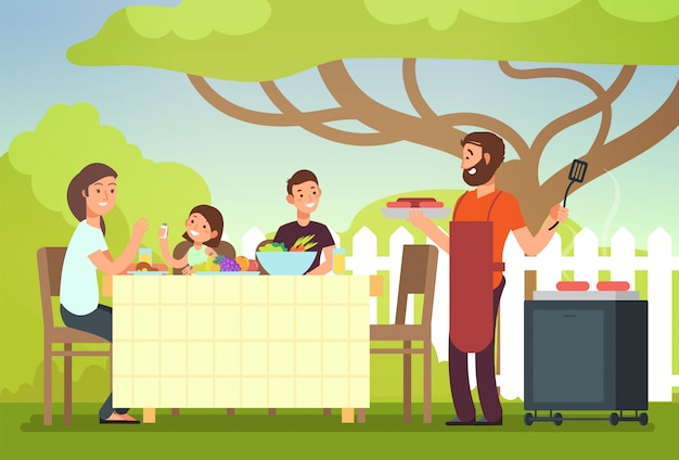 Glückliche familie, die grilloutdoory isst