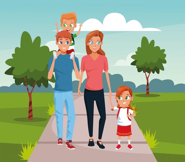 Glückliche familie, die mit kindern über landschaft geht