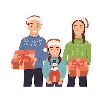 Glückliche familie, die weihnachtsgeschenke in ihren händen hält.