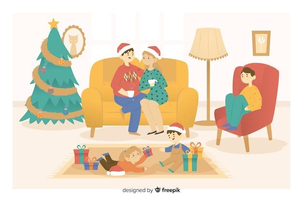 Glückliche familie, die zu hause weihnachten feiert