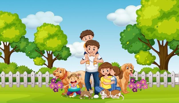 Glückliche familie und haustiere im park