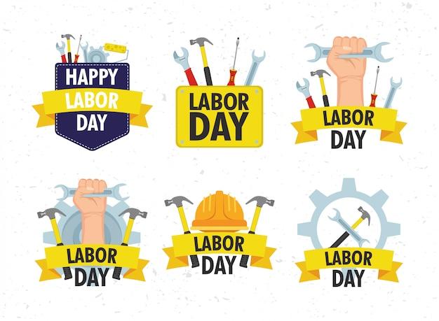 Glückliche feier des arbeitstages mit festgelegten werkzeugen