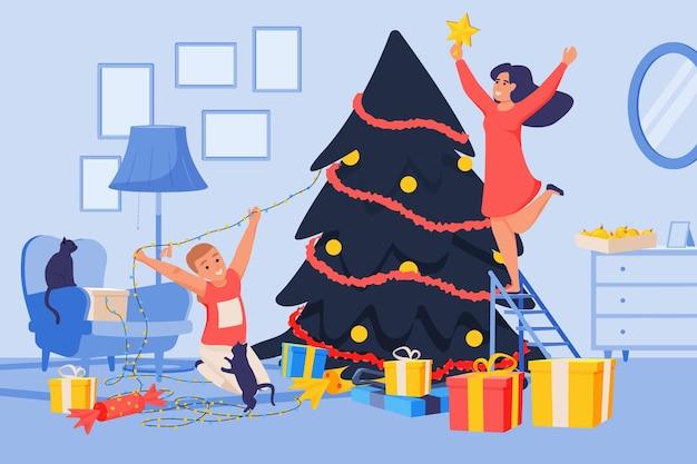 Glückliche feiervolkkomposition mit innenlandschaftsmutter und -sohn, die weihnachtsbaum mit lichterketten verzieren