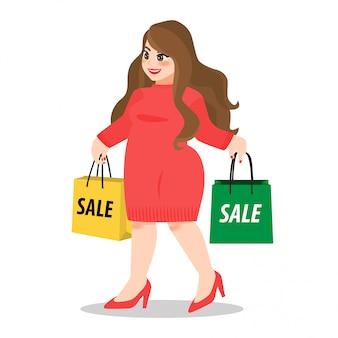 Glückliche fette dame im roten pulloverkleid, das papiereinkaufstaschen auf weißem hintergrund hält
